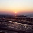 潟平原に沈む夕日